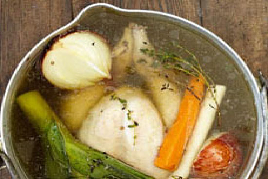 Chicken pot au feu with carrots potatoes and leeks