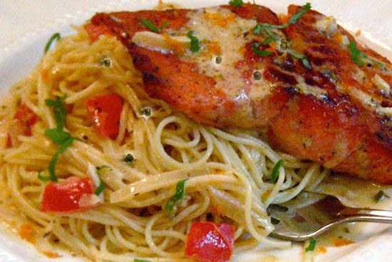 Cajun salmon fillet grenobloise with angel hair pasta